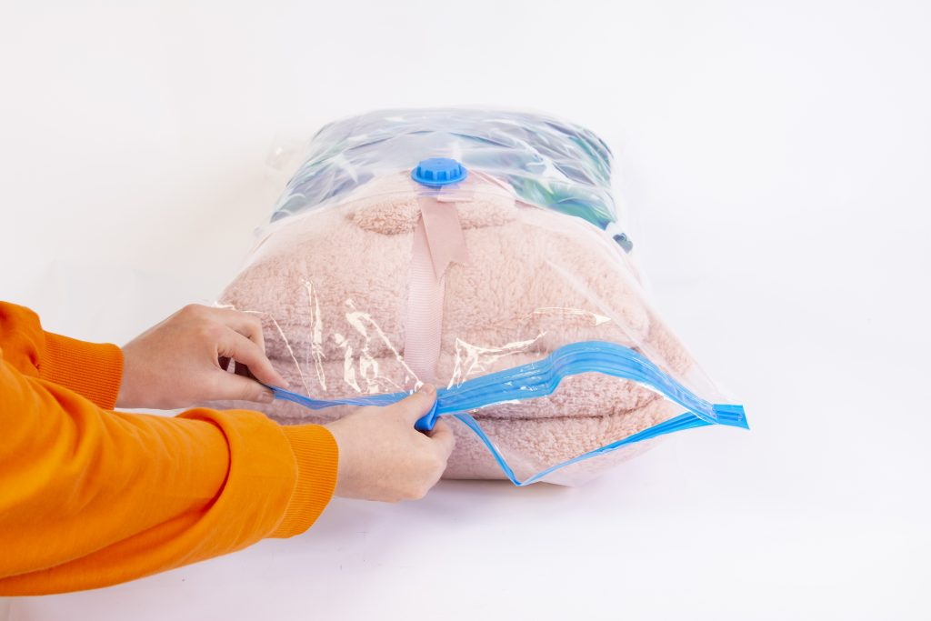 Space saver saving seal bag sucking air vacuum clothing storage compressed package.